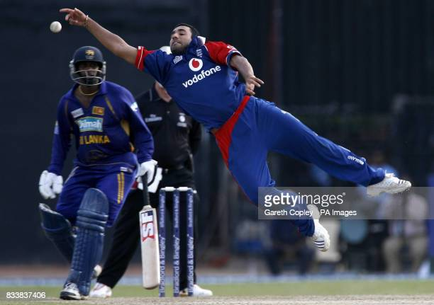 England's Ravi Bopara attempts to catch Sri Lanka's Kumar Sangakkara from his own bowling during the Fourth One Day International at R Premadasa...