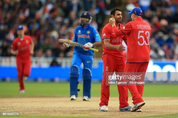 England's Ravi Bopara celebrates the wicket of India's Shikhar Dhawan with James Tredwell during the ICC Champions Trophy Final at Edgbaston...