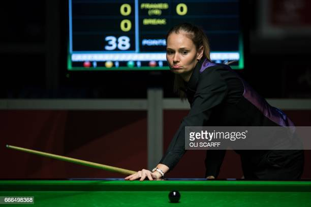 England's Reanne Evans plays a shot against Wales's Lee Walker during their World Snooker Championship second round qualifying match at the at the...