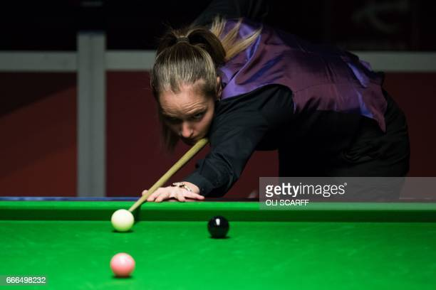 England's Reanne Evans plays against Wales's Lee Walker during their World Snooker Championship second round qualifying match at the at the Ponds...