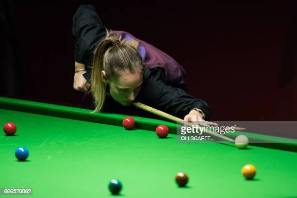 England's Reanne Evans plays against Wales's Lee Walker during their World Snooker Championship second round qualifying match at Ponds Forge...