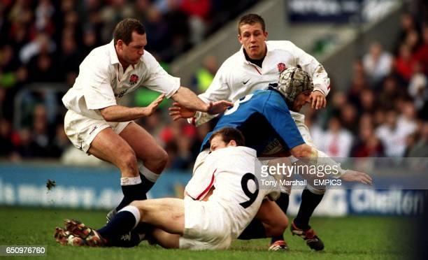 England's Richard Hill Jonny Wilkinson and Matt Dawson combine to stop Italy's Carlo Checchinato