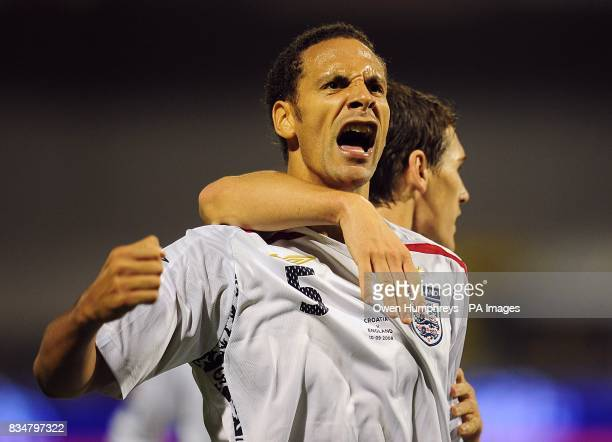 England's Rio Ferdinand and Gareth Barry celebrate team mates Theo Walcott's goal