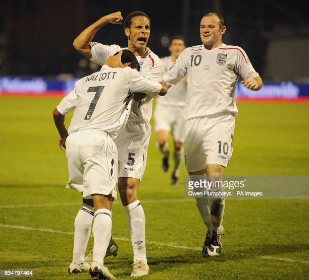 England's Rio Ferdinand and Wayne Rooney congratulate team mate Theo Walcott after he scored the first goal