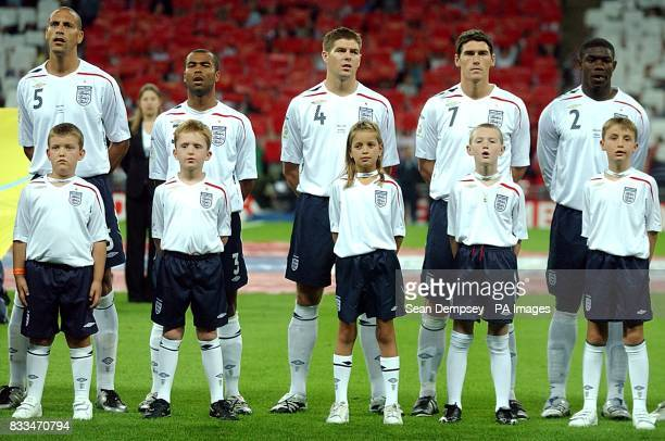 England's Rio Ferdinand Ashley Cole Steven Gerrard Gareth Barry and Micah Richards line up for the national anthem