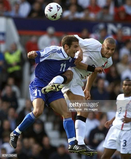 England's Rio Ferdinand battles for the ball against Themis Nikolaidis of Greece during the FIFA World Cup European Qualifying Group Nine match at...