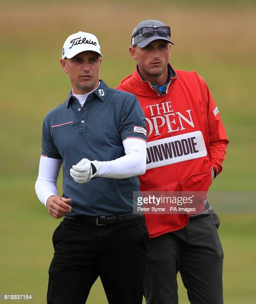 England's Robert Dinwiddie and his caddie during day one of The Open Championship 2017 at Royal Birkdale Golf Club Southport