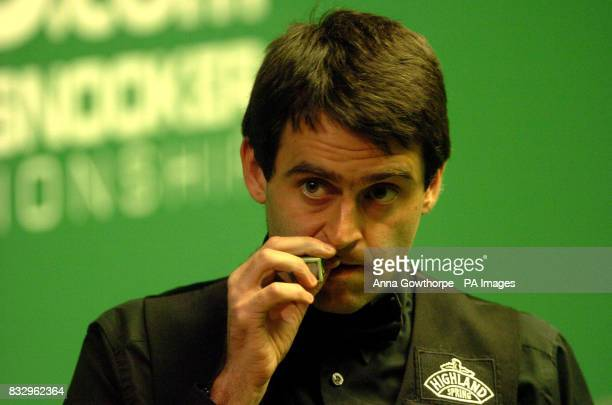 England's Ronnie O'Sullivan bites on his nails during the second round match of the World Snooker Championships at the Crucible Theatre Sheffield