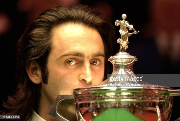 England's Ronnie O'Sullivan celebrates with the trophy after beating Scotland's Graeme Dott 18 8 frames at the Final of the Embassy World...