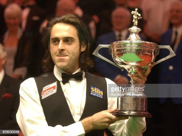 England's Ronnie O'Sullivan celebrates with the trophy after beating Scotland's Graeme Dott 188 frames at the Final of the Embassy World Championship...