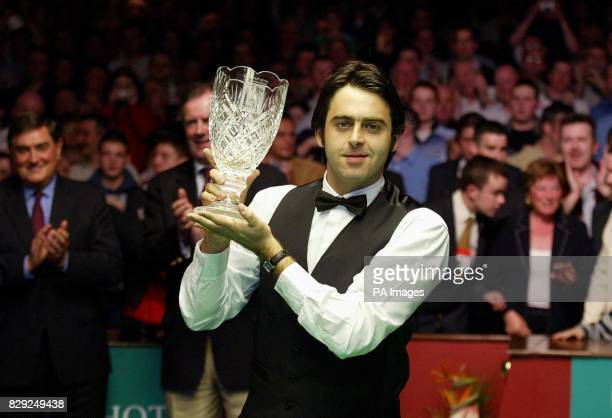 England's Ronnie O'Sullivan looks proudly at his crystal trophy after beating Scotland's John Higgins by 10 9 in frames in the final of the Irish...