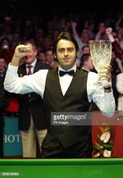 England's Ronnie O'Sullivan with his crystal trophy after beating Scotland's John Higgins by 10 9 in frames in the final of the Irish Masters Snooker...