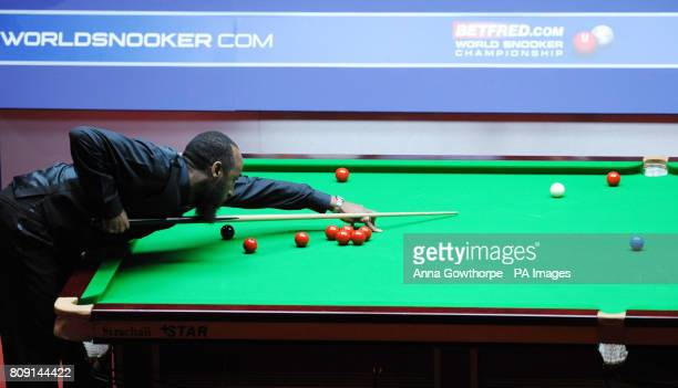 England's Rory McLeod at the table during his second round match in the Betfredcom World Snooker Championships at the Crucible Sheffield
