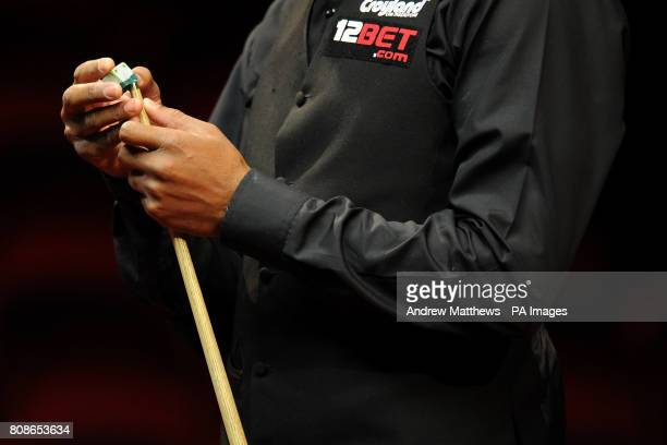 England's Rory McLeod chalks his cue during the 12BetCom UK Championships at the Telford International Centre Telford