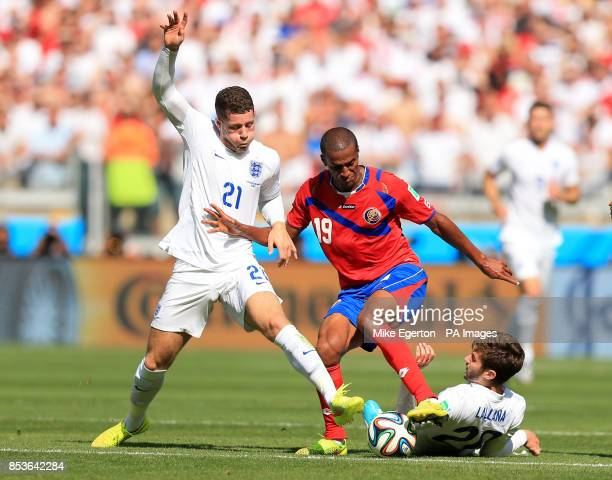 England's Ross Barkley and Adam Lallana battle for the ball with Costa Rica's Roy Miller during the FIFA World Cup Group D match at the Estadio...
