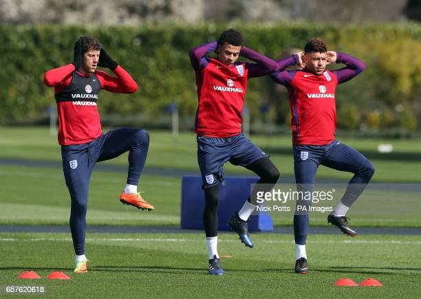 England's Ross Barkley Dele Alli and Alex OxladeChamberlain during the training session at Enfield Training Ground London