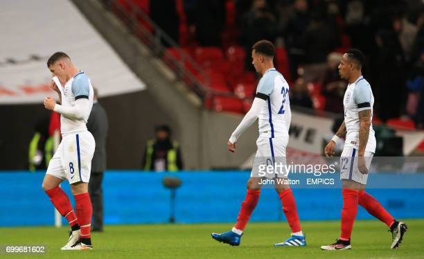 England's Ross Barkley Dele Alli and Nathaniel Clyne appear dejected after the final whistle during the International Friendly match at Wembley...