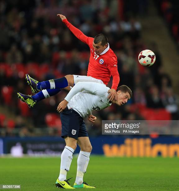 England's Ross Barkley is outjumped by Chile's Gary Medel