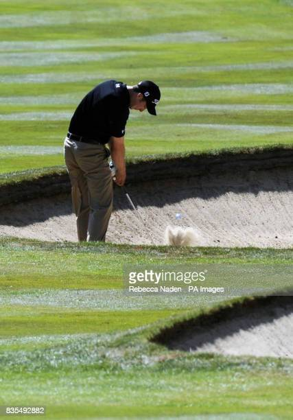 England's Ross Fisher plays his second shot to the 3rd green during Round 4 of the BMW PGA Championship at Wentworth Golf Club Surrey