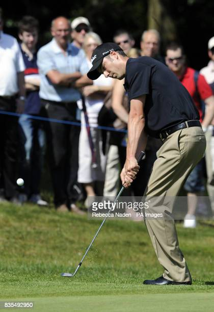 England's Ross Fisher plays his third shot to the 3rd green during Round 4 of the BMW PGA Championship at Wentworth Golf Club Surrey