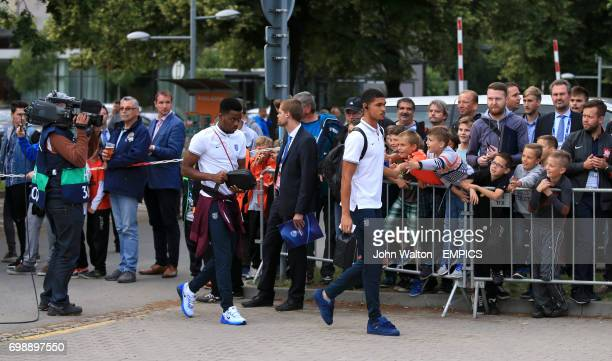England's Ruben LoftusCheek and Nathaniel Chalobah pass fans as they enter the stadium before the match