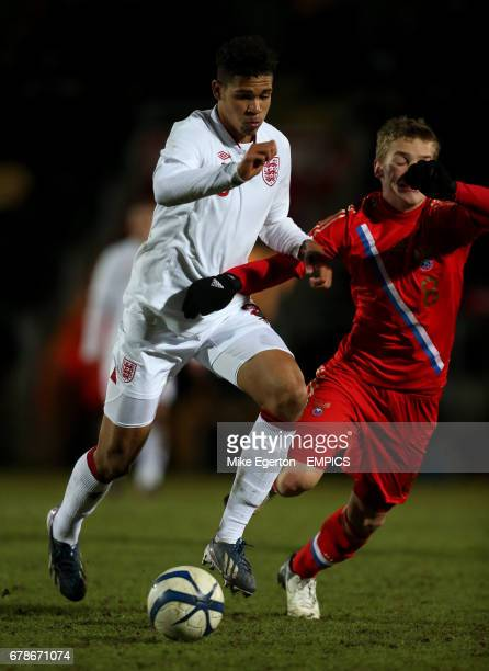 England's Ruben LoftusCheek and Russia's Danila Buranov battle for the ball