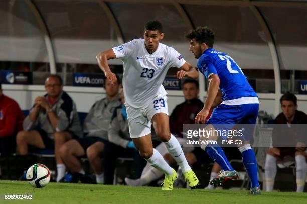 England's Ruben LoftusCheek battles for the ball with Danilo Cataldi