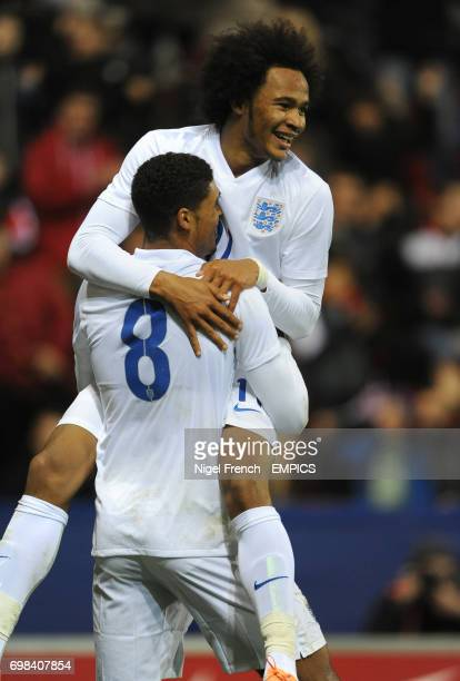 England's Ruben LoftusCheek celebrates with Isaiah Brown after scoring his sides third goal of the game against Italy