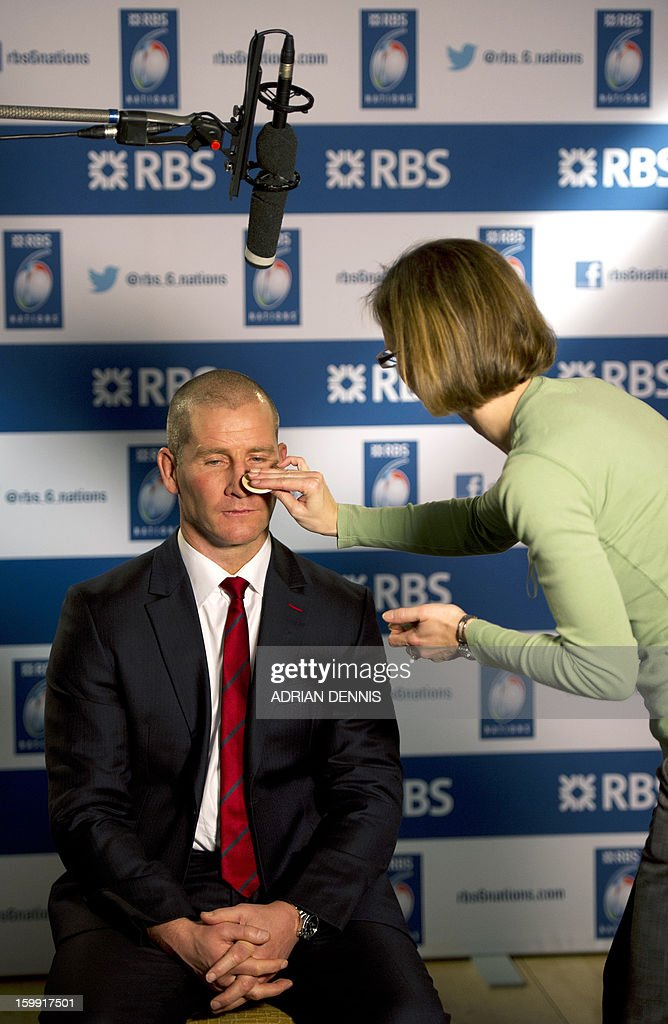 England's rugby coach Stuart Lancaster has powder applied to his face ahead of a television interview during the official launch of the 2013 Six Nations International rugby tournament at the Hurlingham Club in London on January 23, 2013. The tournament kicks-off February 2 with Wales versus Ireland. AFP PHOTO / ADRIAN DENNIS