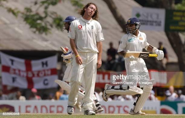 England's Ryan Sidebtottom reacts as Sri Lanka's Kumar Sangakkara and Mahela Jayawardene run between the wickets during the first Test match at...