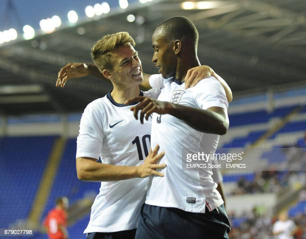 England's Saido Berahino celebrates with Tom Carroll after scoring the opening goal of the game against Moldova during the UEFA Euro Under 21's...