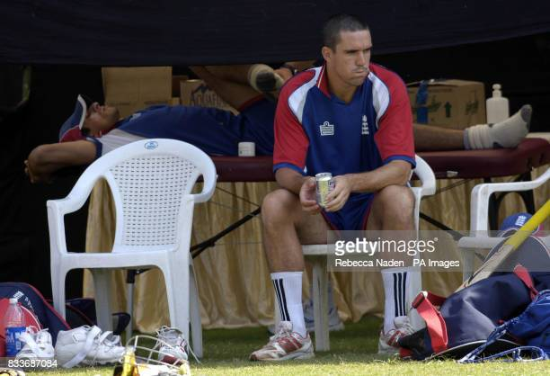 England's Sajid Mahmood and Kevin Pietersen relax during a nets practice session at the Sardar Patel Stadium Ahmedabad India