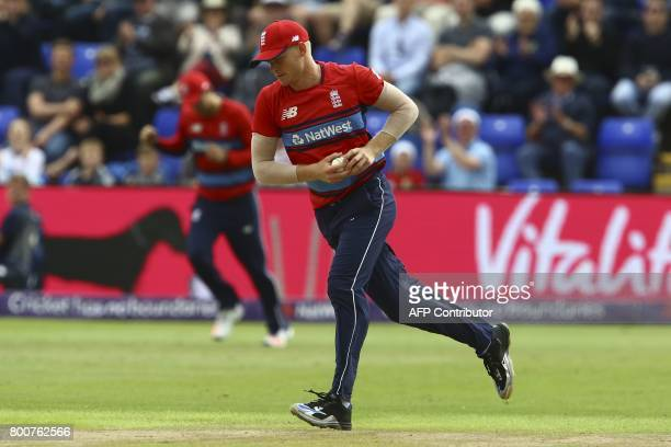 England's Sam Billings runs after catching the ball to take the wicket of South Africa's Farhaan Behardien during the third Twenty20 international...
