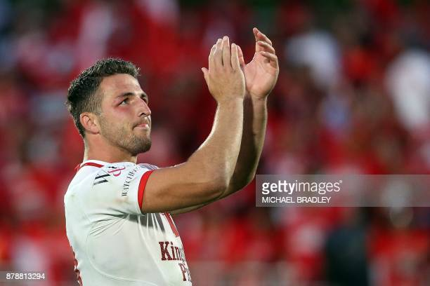 England's Sam Burgess acknowledges fans during the Rugby League World Cup men's semifinal match between Tonga and England at Mt Smart Stadium in...