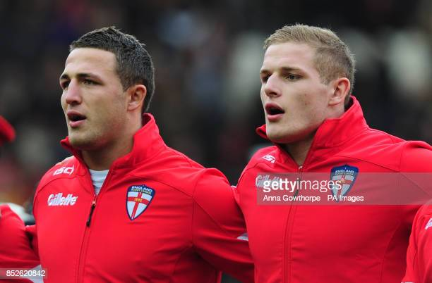 England's Sam Burgess and his brother George Burgess line up before the 2013 World Cup match at the KC Stadium Hull