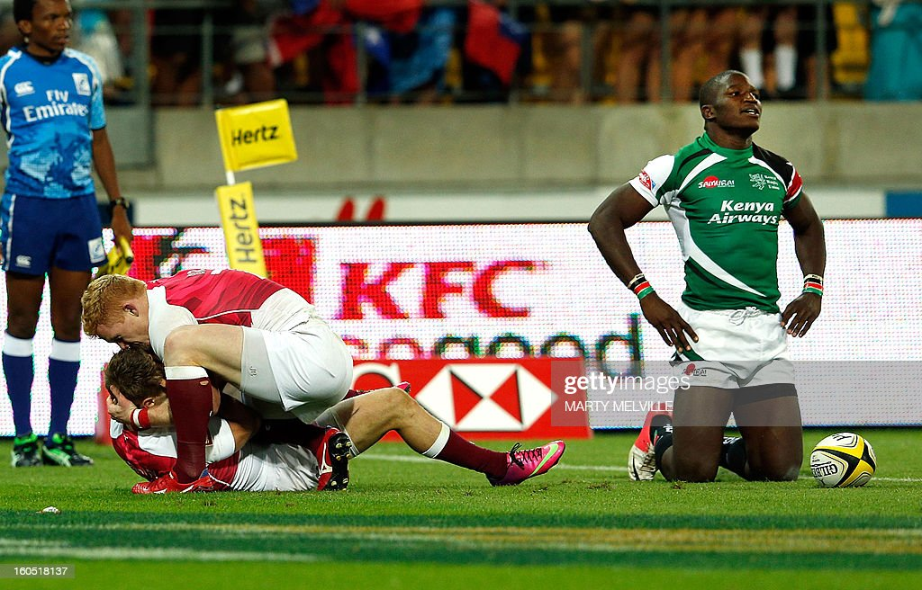 England's Sam Edgerley (L) and John Brake celebrate winning as Kenya's Davis Chenge reacts during the cup final at the Westpac Stadium on day two of the fourth leg of the IRB Rugby Sevens World Series in Wellington on February 2, 2013. AFP PHOTO / Marty MELVILLE