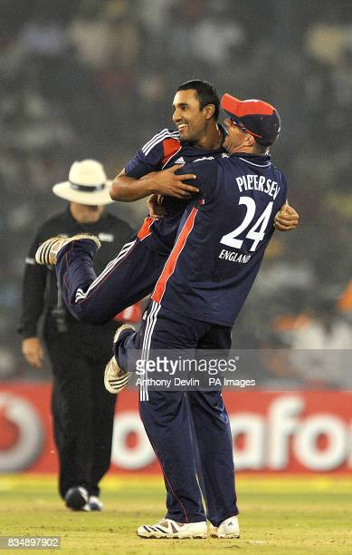 England's Samit Patel is congratulated by Kevin Pietersen after taking the wicket of Yuvraj Singh during the Fifth One Day International at the...