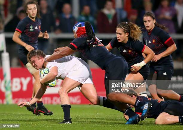 TOPSHOT England's Sarah Bern is tackled by France's Safi N'Diaye during the Women's Rugby World Cup 2017 semifinal match between England and France...