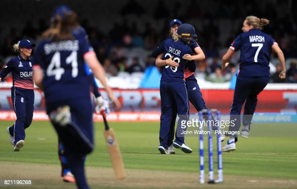 England's Sarah Taylor celebrates the wicket of India's Mithali Raj with teammates during the ICC Women's World Cup Final at Lord's London