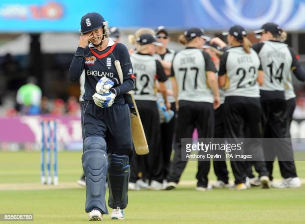 England's Sarah Taylor reacts as she leaves the field after being caught by New Zealand's Rachel Priest off the bowling of Kate Pulford during the...