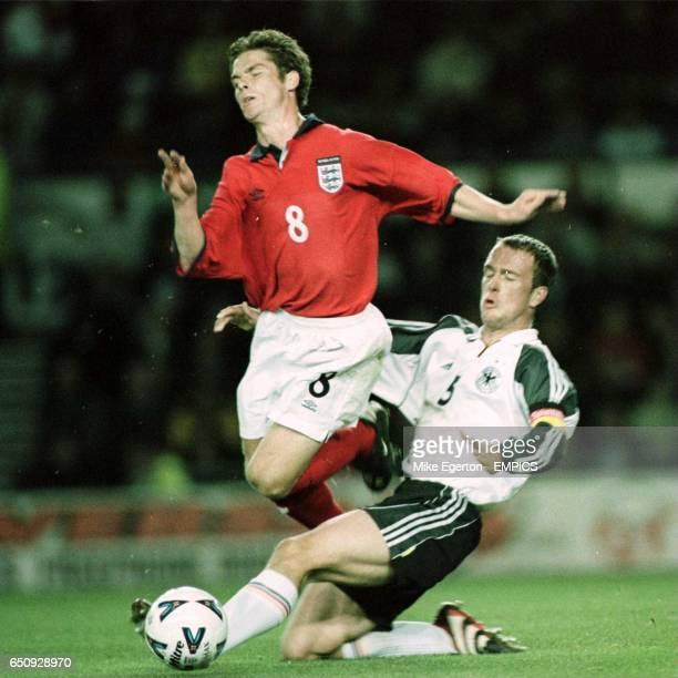 England's Scott Parker is tackled by Germany's Fabien Ernst