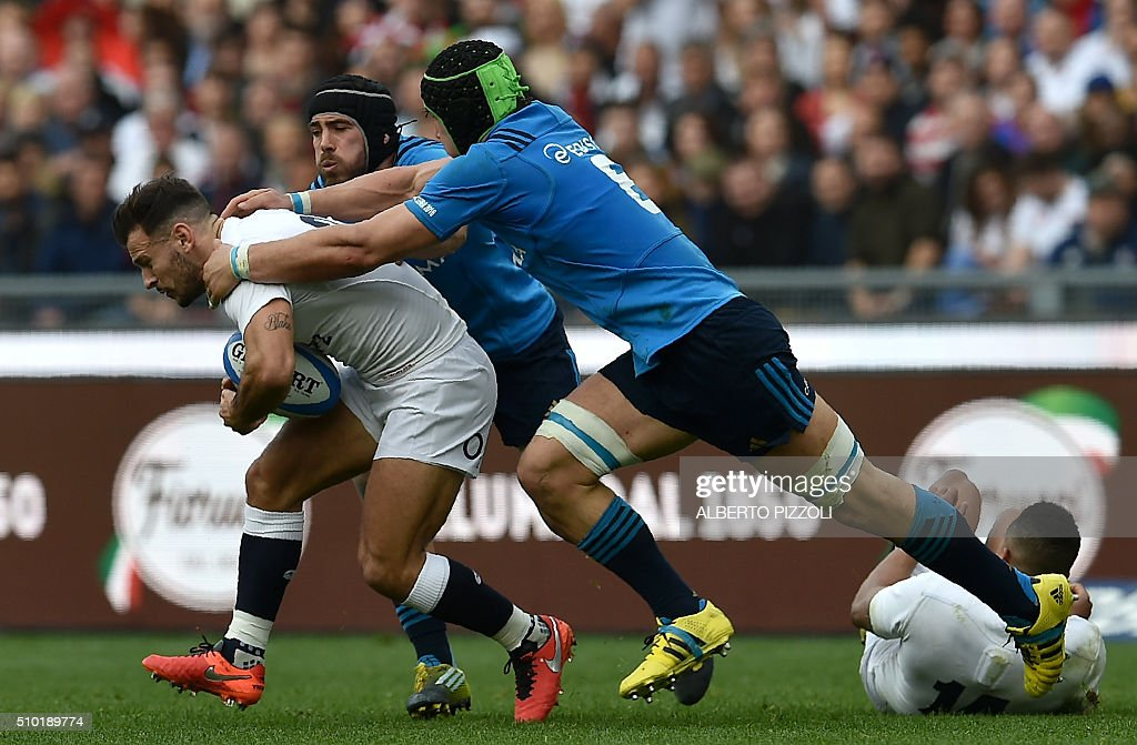 England's scrum half Danny Care (L) is tackled during the Six Nations international rugby union match between Italy and England on February 14, 2016 at the Olympic stadium in Rome. / AFP / ALBERTO PIZZOLI
