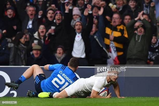 England's scrumhalf Danny Care dives over the line to score a try during the Six Nations international rugby union match between England and Italy at...