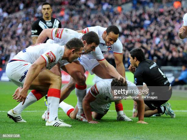 England's Sean O'Loughlin is congratulated by Sam Burgess Brett Ferres and Leroy Cudjoe after scoring a try during the World Cup Semi Final at...