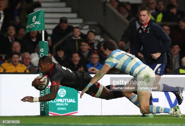 England's Semesa Rokoduguni scores his sides second try during the Old Mutual Wealth Series match between England and Argentina at Twickenham Stadium...