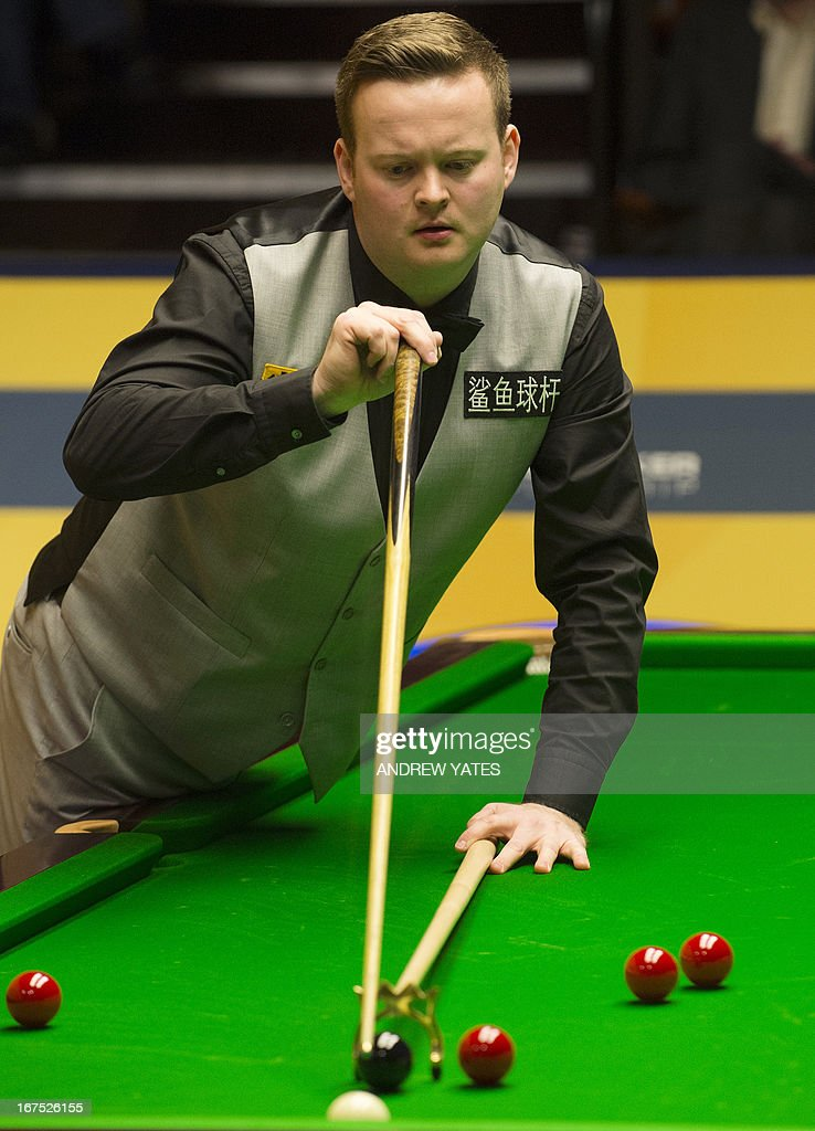 England's Shaun Murphy lines-up a shot during the World Snooker Championship 2013 second round match against Scotland's Graeome Dott at The Crucible in Sheffield, England, on April 26, 2013.