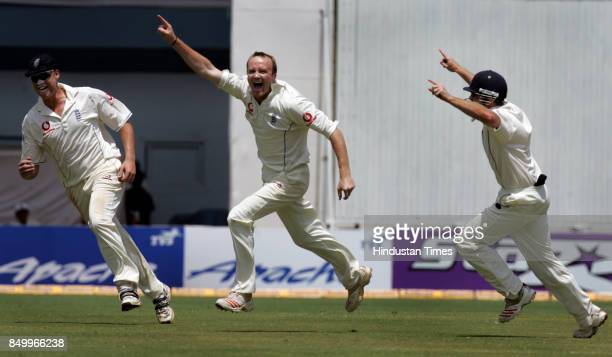 England's Shaun Udal celebrates with captain Andrew Flintoff after dismissing India's Sachin Tendulkar in the third and final test cricket match...