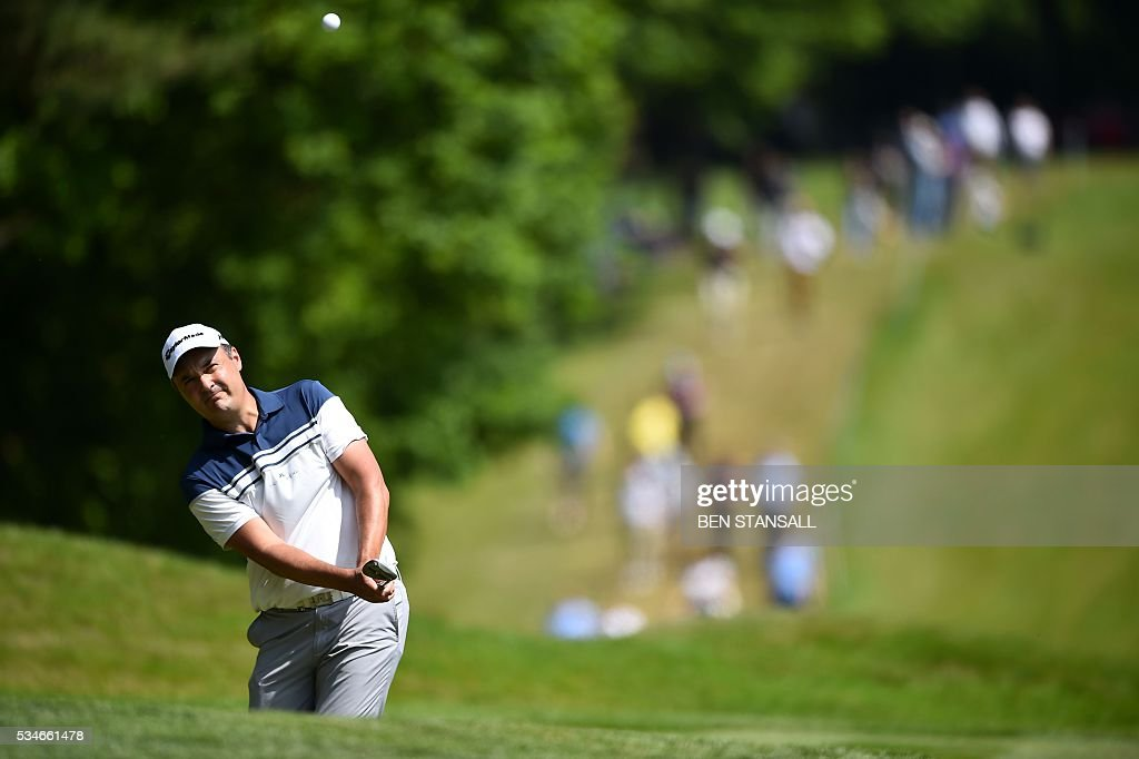 England's Simon Kahn plays an approach shot to the 1st green during the second day of the PGA Championship at Wentworth Golf Club in Surrey, south west of London, on May 27, 2016. / AFP / BEN