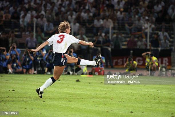 England's Staurt Pearce takes his penalty during the shootout only for West Germany goalkeeper Bodo Illgner to save it