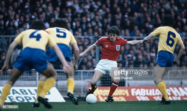 England's Steve Coppell is faced by three Romanian defenders during the World Cup Qualifying match at Wembley Stadium 29th April 1981 The match ended...
